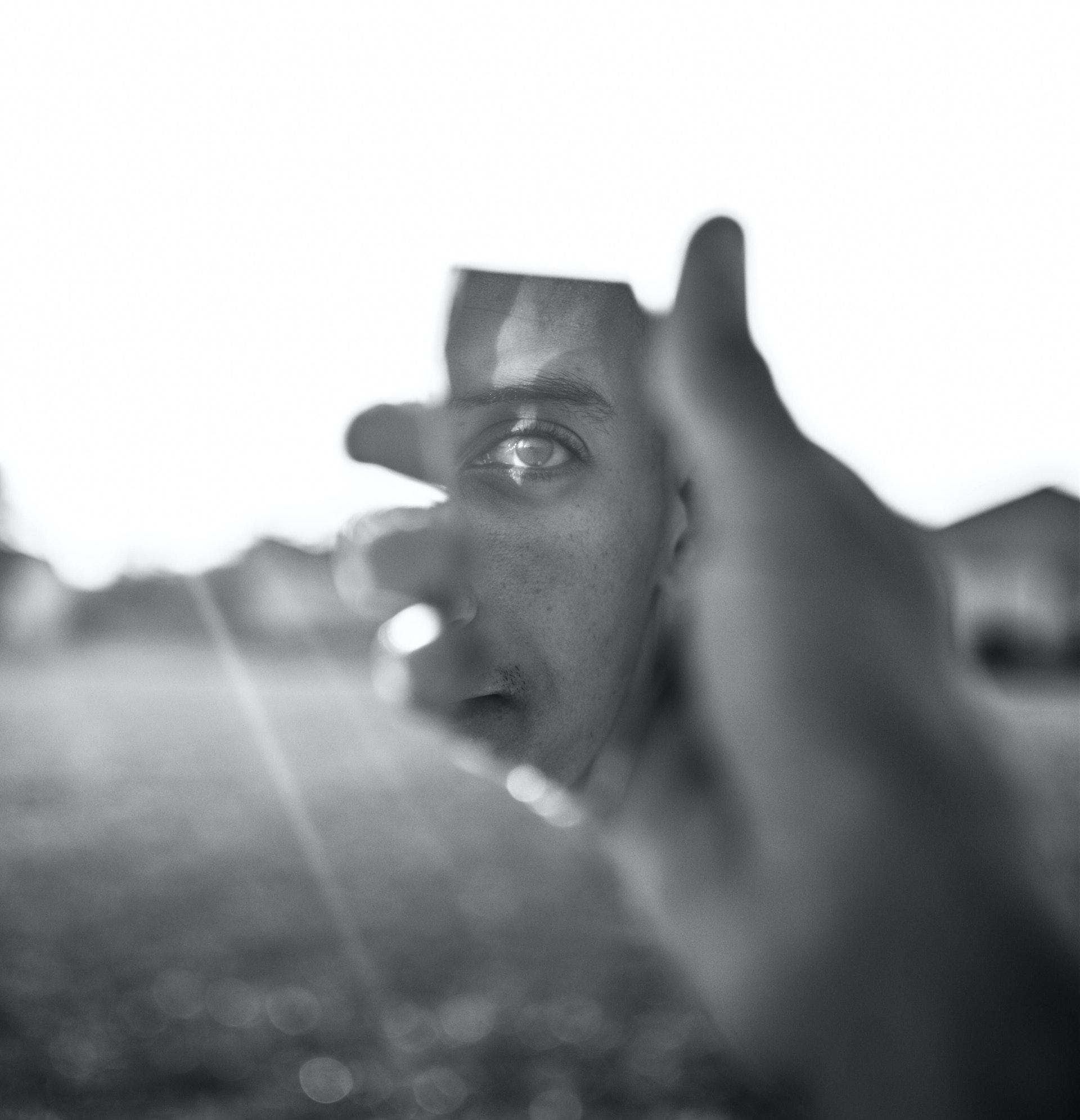 Grayscale Photo of Human Hand