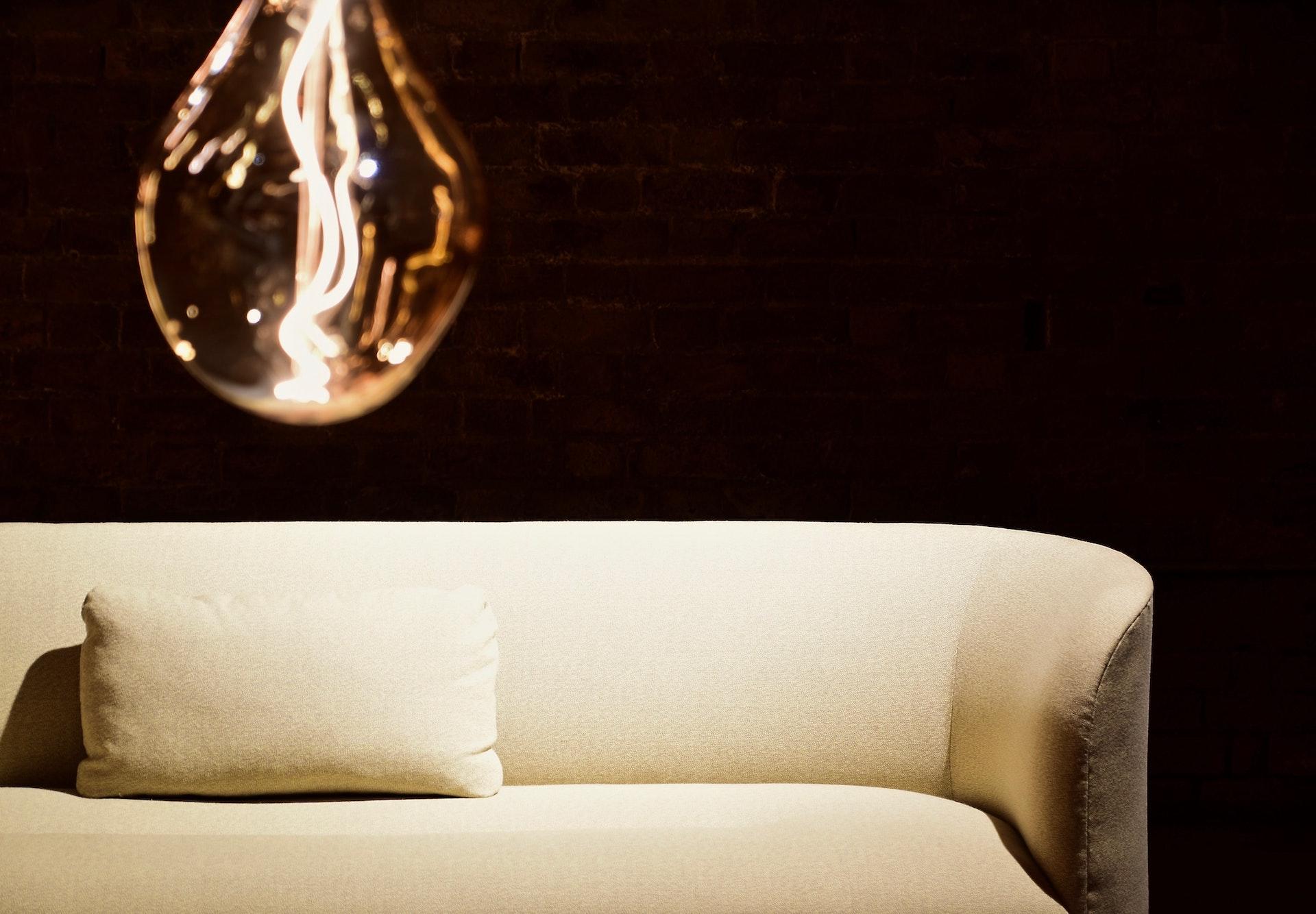 White Pillow on White Leather Sofa