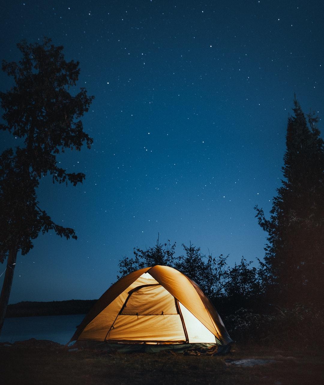 Tent Near Trees and Lake at Night