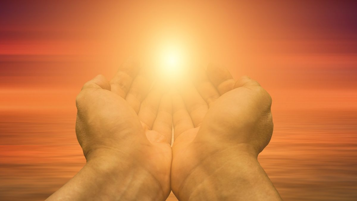 Hands toward light