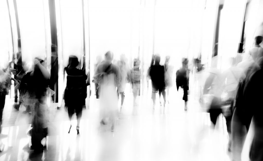 business people activity standing and walking in the lobby motion blurred black and white
