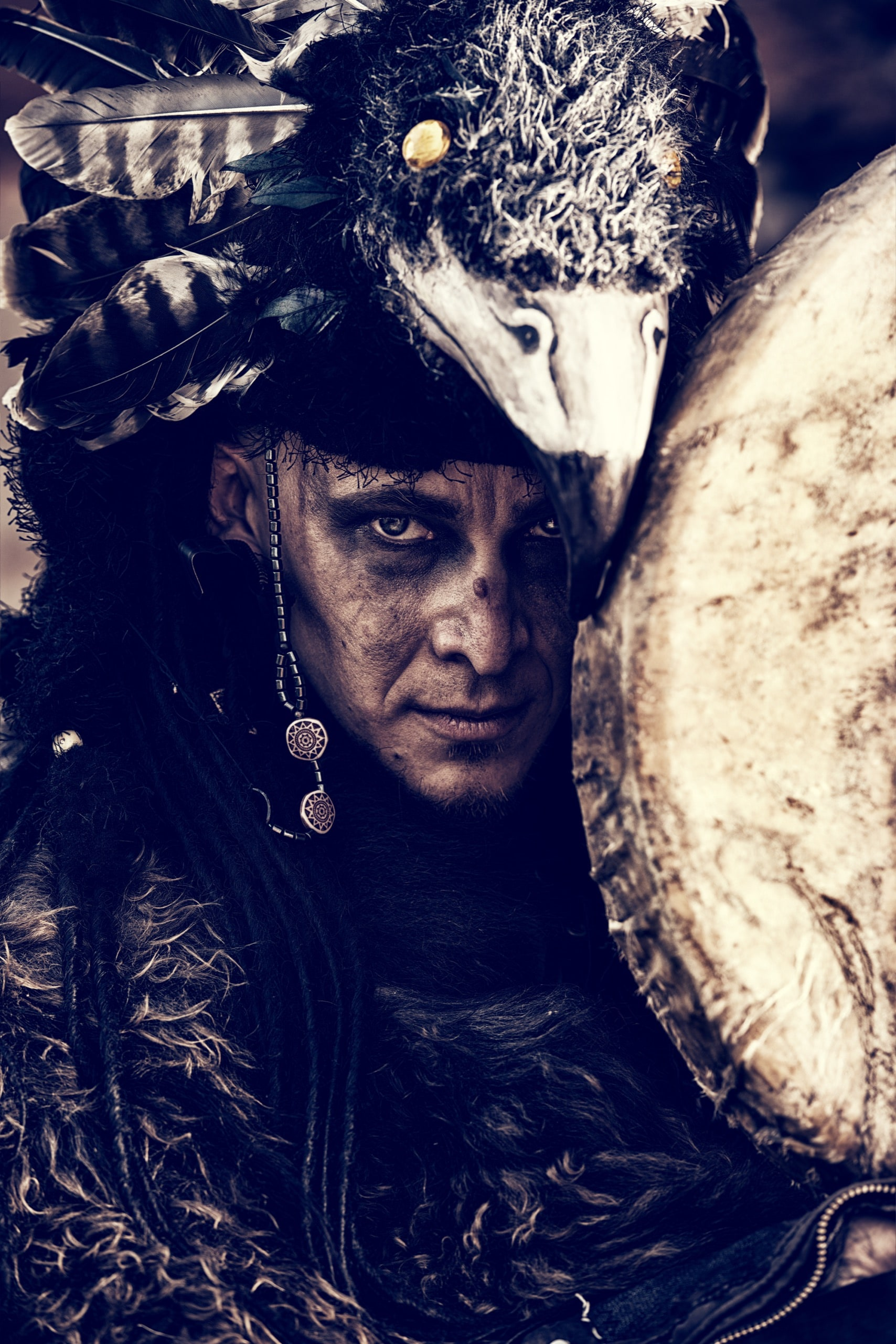Portrait of a shaman with a drum outdoor.