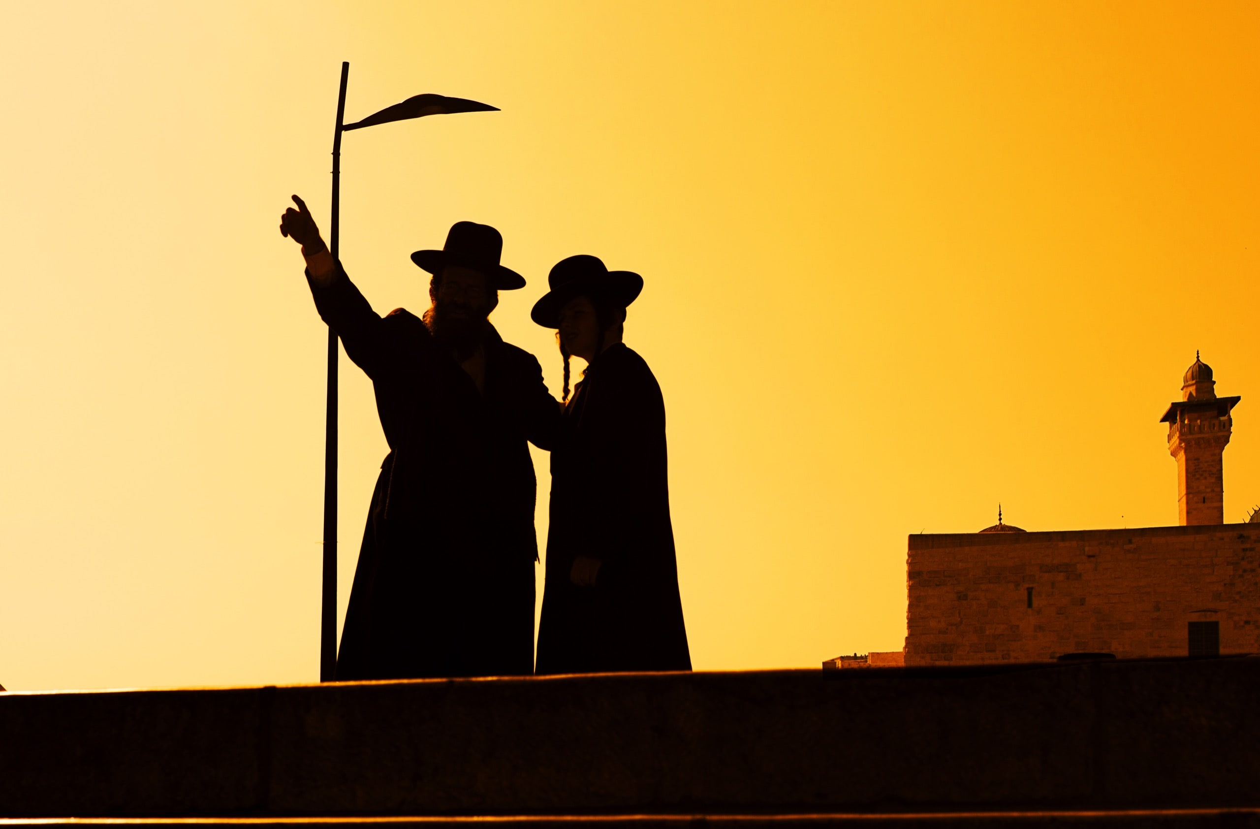 Silhouette of jewish people at sunset in Jerusalem